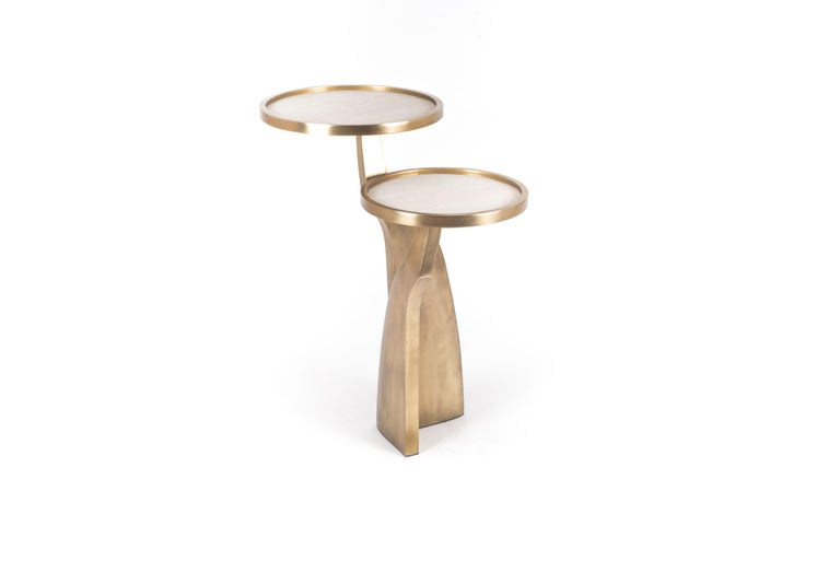 The Chital 2-top side table is both dramatic and organic it's unique design. The cream shagreen inlaid 2-top sits at different levels, on a pair of ethereal and sculptural bronze-patina brass legs. This piece makes for the perfect end table and is