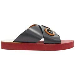 CHLOE black cross strap leather trimmed large grommet red rubber slides EU37