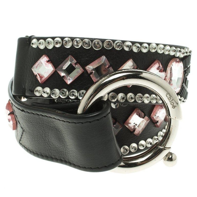 It's time you treated yourself to a chic and stylish belt and what better than this black one from Chloe. The Italian-made belt is crafted from leather and it flaunts intricate crystals and stone detailing along with a silver-tone chunky buckle.