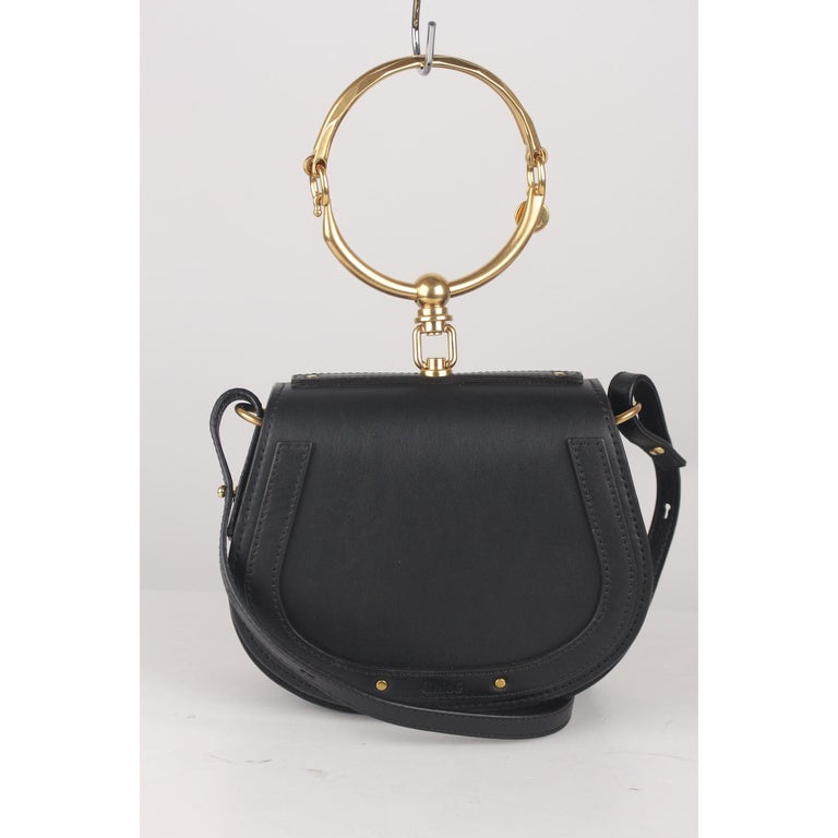 We offer Certificate of Authenticity provided by Entrupy for this item at no further cost.  Chloé's 'Nile' bracelet bag. Crafted of black leather and suede. A beautiful day-to-evening bag from the Chloe 2017 summer collection. It feautures CHLOE'