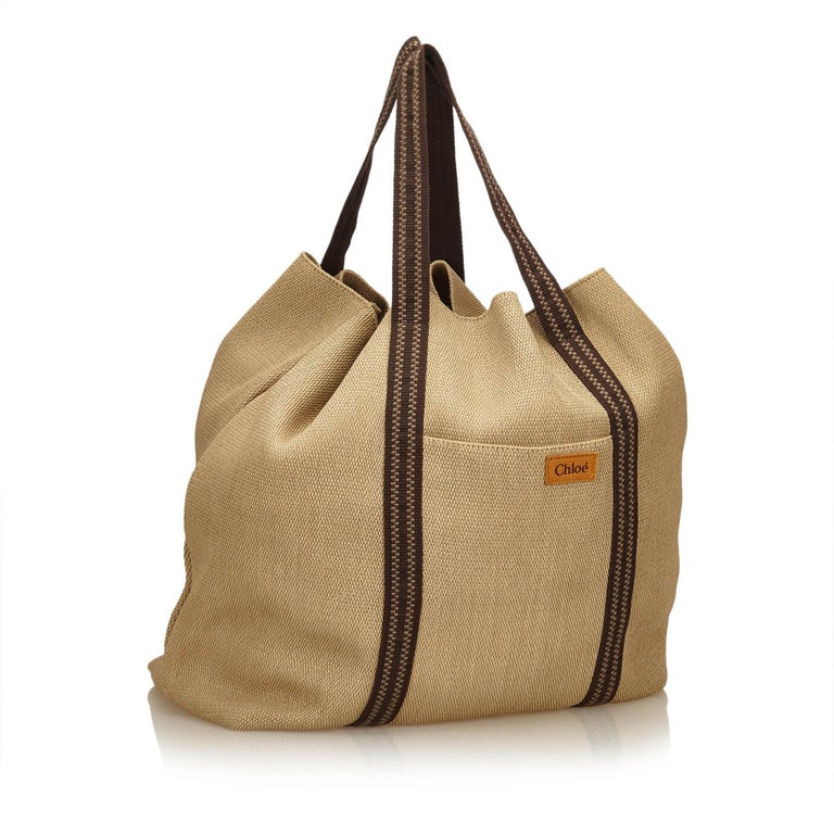 This tote bag features a rayon body, flat straps, open top, and interior slip pockets. It carries as AB condition rating.  Inclusions:  This item does not come with inclusions.  Dimensions: Length: 45.00 cm Width: 40.00 cm Depth: 24.00 cm Shoulder