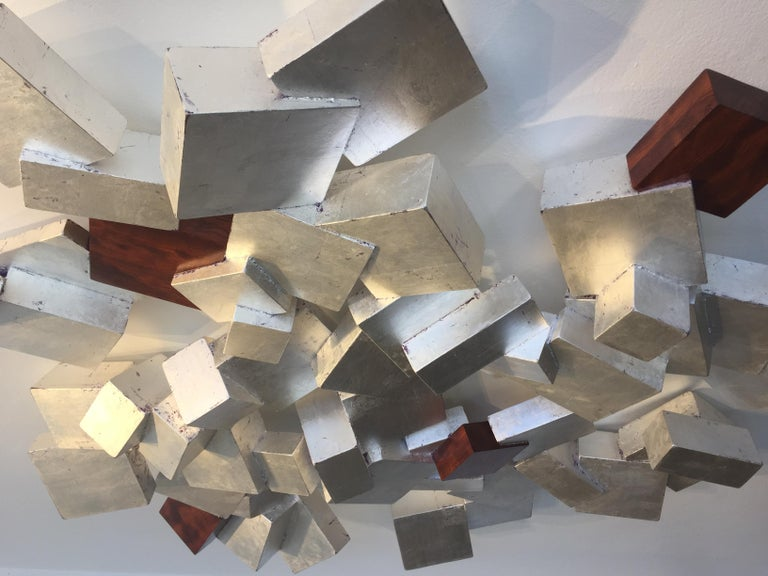 *materials; Sterling Silver Leaf on Paulownia with Bubinga Facets  This series by Chloe Hedden and Bill Hedden explores the growth forms of the mineral pyrite. Pyrite or 'fools gold' grows in organic ever expanding interconnected cubes. This father