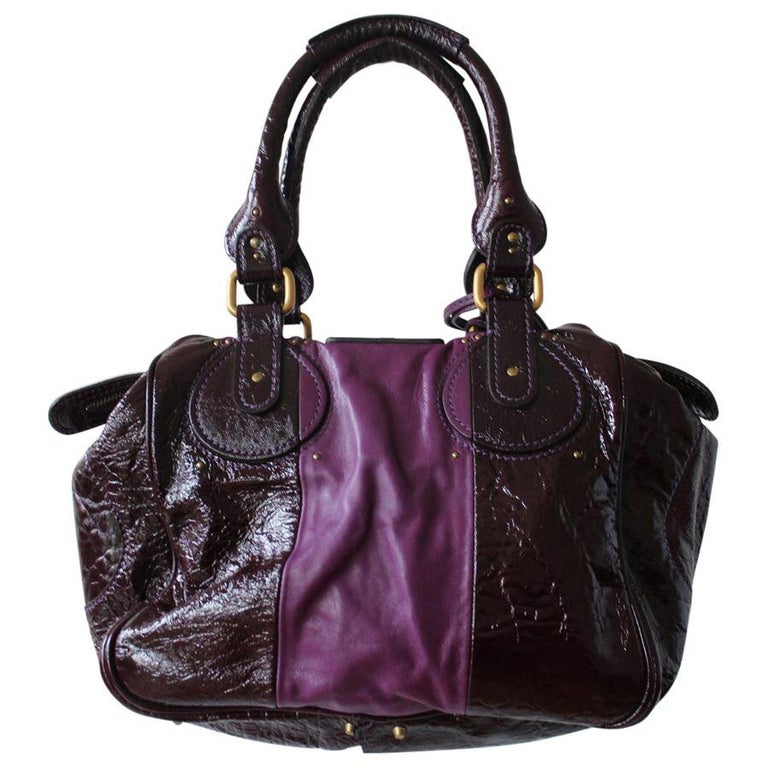 Iconic Chloe Paddington bag Leather and patent Purple color Two handles Double zip closure Internal zip pocket Bronze metal inserts Key locker with key Cm 45 x 26 x 12 (17.7 x 10.2 x  4.72 inches) Worldwide express shipping included in the price !