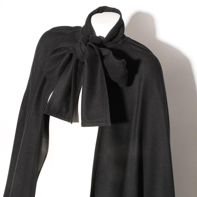 Wool Twill Cape by Karl Lagerfeld for Chloé Circa 1970's Black  Necktie closure Draped cape no sleeves No hood Wool Made in France Condition: Excellent condition, little to no visible wear (see photos)  Size/Measurements: (approximate, taken