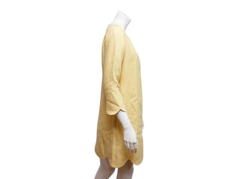 Product details:  Yellow scallop-trimmed shift dress by Chloe.  Roundneck.  Three-quarter length sleeves.  Concealed back zip closure.  Label size FR 40.  38