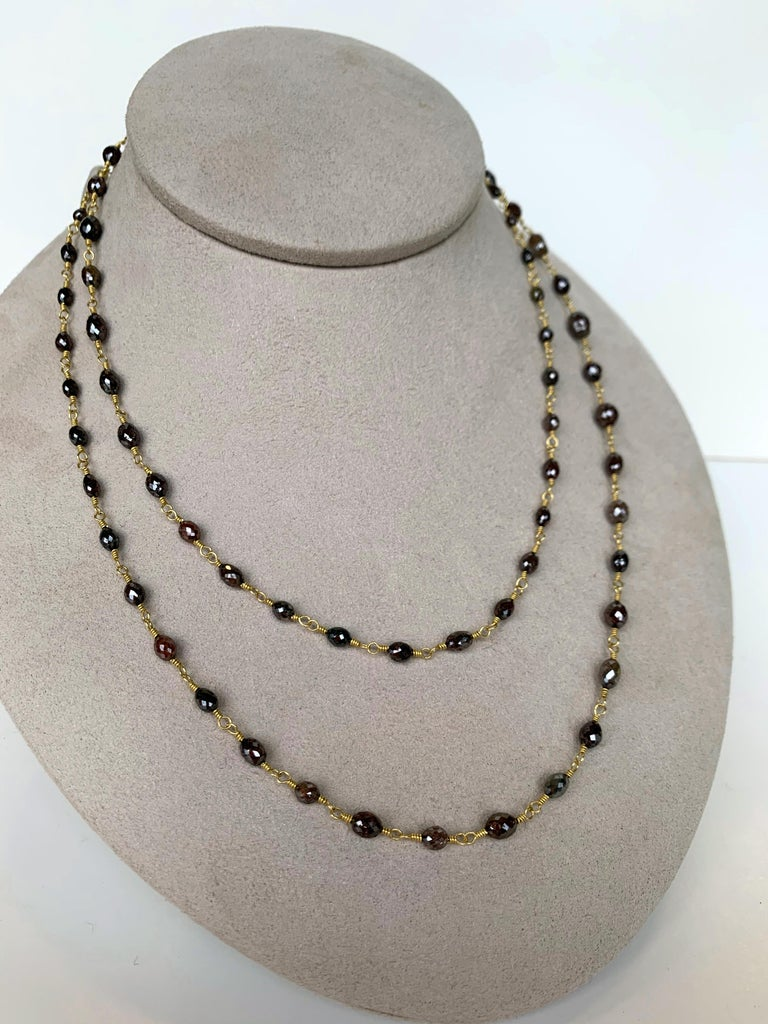 Faceted oval diamond beads weighing 49 carats in subtle shades of