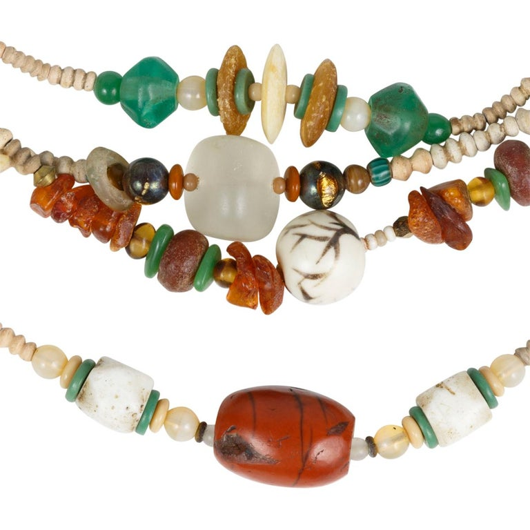 Hummingbird fetish necklace made by Choctaw artist Robert Kaniatobe(1936-1998). Eight hand-carved walrus ivory fetishes strung with beads, ancient Mali clay, hand carved jasper, agate, Baltic amber, shell, bone, quartz crystal, horn, brass, copper,