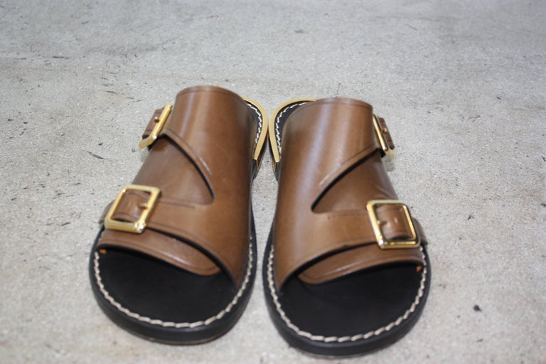 Chloe tan slip on buckle sandals. Little to no wear to soles Minor scratches to leather. Size 36  Barely Worn. Very comfortable as they are a slip on sandal.
