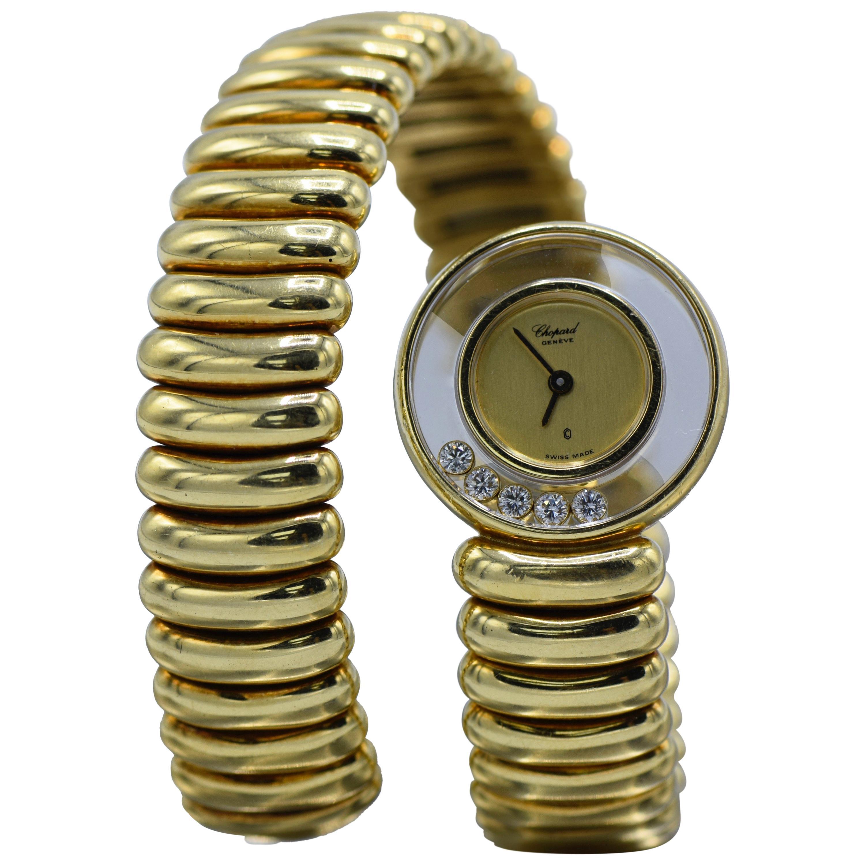 Chopard, 18 Karat Gold, Diamond, and Ruby 'Happy Diamond' Watch