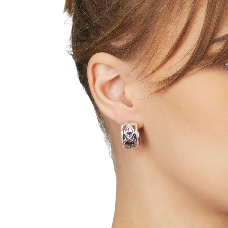 These Earrings by Chopard are from their Imperiale collection and feature 8 Amethysts and 66 round brilliant cut Diamonds of 0.45ct total colour G, clarity VS, made in 18k White Gold. These Earrings have secure latch backs. Complete with Xupes