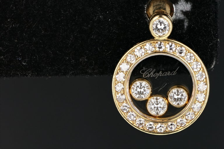 Designer: Chopard  Composition: 18K  Carat Weight:  .31 CTW  Color : G-H  Clarity: VS  Earring Weight: 7 Grams  Earring Height: 15mm  Earring Length: 10mm