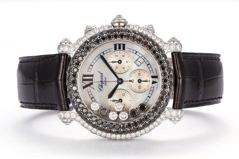We are pleased to offer this Chopard 18k White Gold & Diamond Happy Sport 28/3340-50. This watch features a brand new Chopard leather strap, quartz movement, mother-of-pearl dial with Roman numerals and outer minute track, blued steel hands,