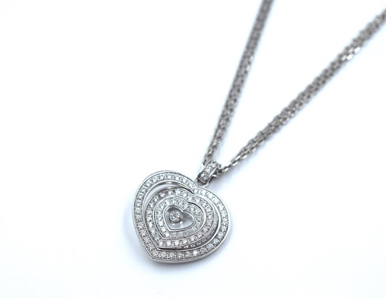 This amazing pendant from Chopard's Happy Spirit collection. Three diamond set heart shape frames decrease in size towards the central single iconic floating diamond. Crafted in all 18k white gold with a18k white gold double strand chain running