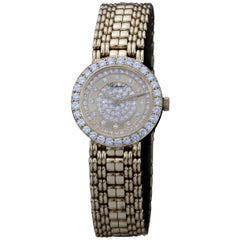 Chopard A Ladies 18 Karat Gold and Diamond-Set Wristwatch