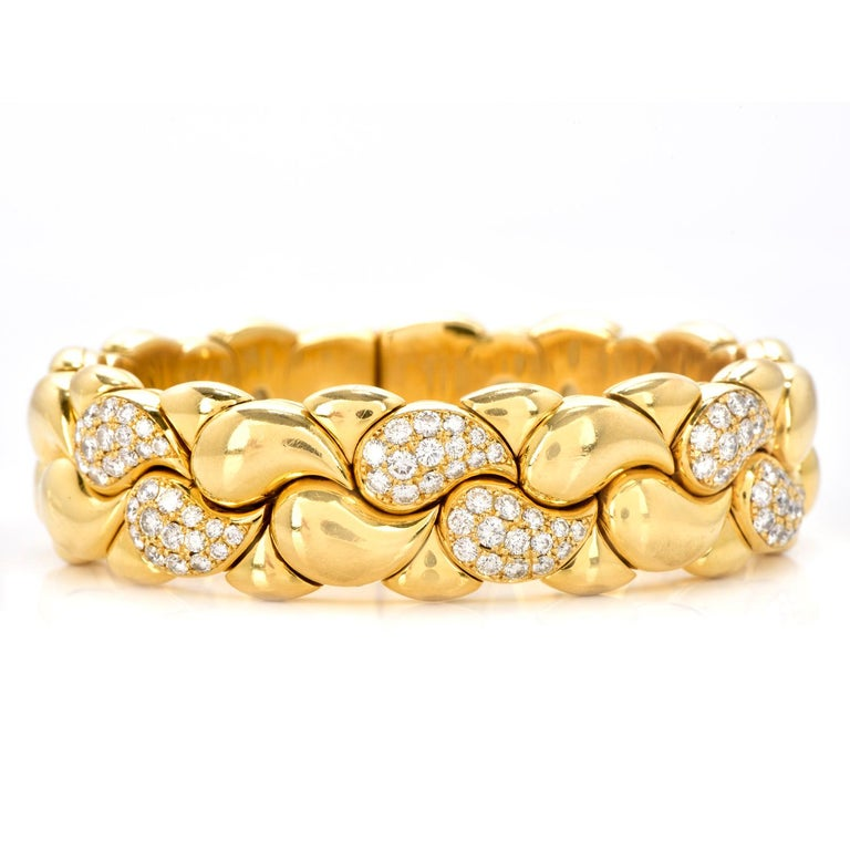 This is an exquisite Chopard Casmir Diamond 18K Gold Braided Designer  cuff bangleBracelet is flexible and the perfect complement for any ensemble weighing approximately 114.9 grams.  Expertly crafted in solid heavy 18K yellow gold, featuring (84)