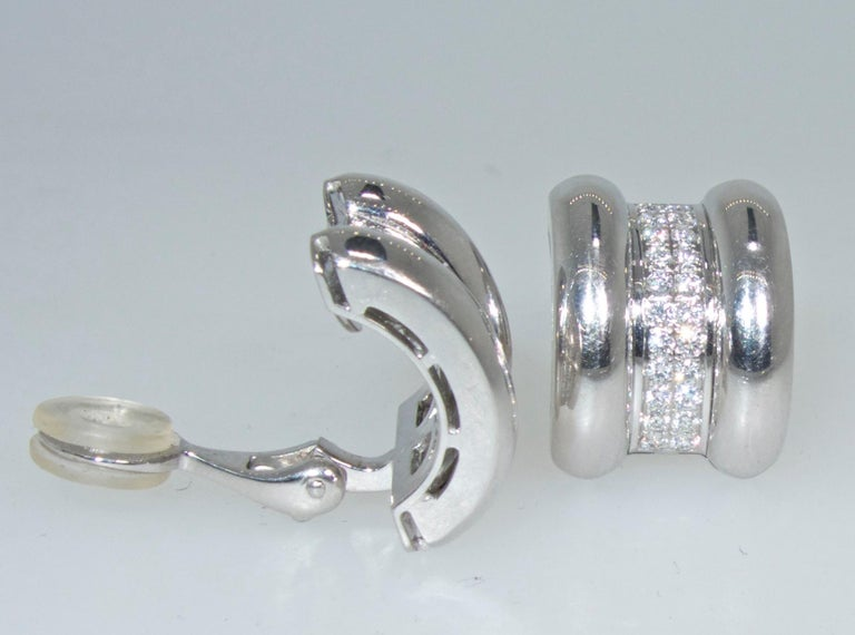 18K white gold with fine white diamonds.   There are 44 well cut, well matched fine round brilliant cut diamonds weighing approximately 1. ct.  These earrings made by the world famous jewelry and watch house, Chopard are in new like condition and