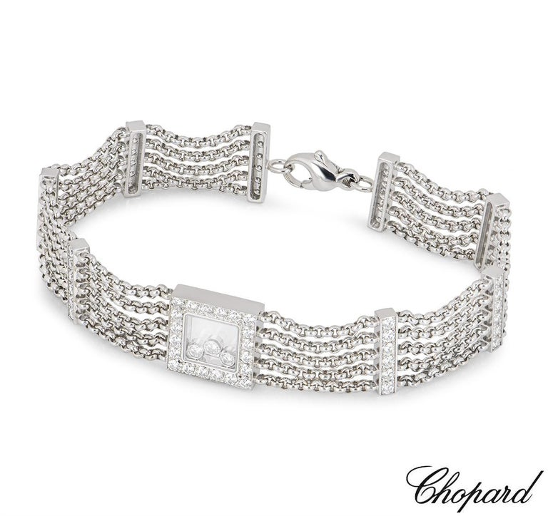 An 18k white gold bracelet from the Chopard Happy Curves collection. The bracelet is set to the centre with a single square motif, pave set with round brilliant cut diamonds, featuring 3 floating round brilliant cut diamonds enclosed behind the