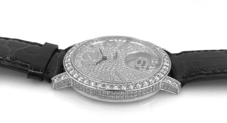 18k white gold three floating diamonds sports watch, signed Chopard.