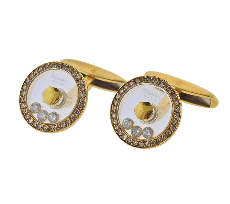 Pair of 18k gold Happy Diamonds cufflinks by Chopard, with approx. 0.70ctw in FG/VVS diamonds.  Cufflink top is 18mm in diameter. Marked: Chopard, 750, LUC. Weight - 17.5 grams.