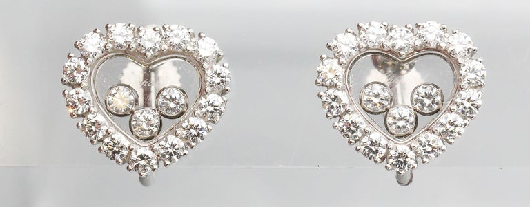 Fine 18K white gold and diamond earrings from the