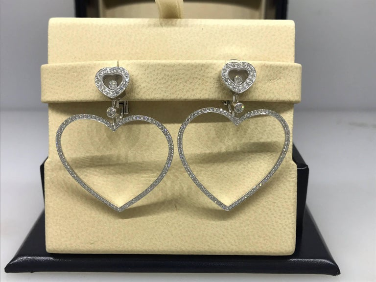 Chopard Happy Diamonds Large Heart Earrings  Model Number: 84/6467-1001  100% Authentic  Brand New  Comes with original Chopard box, certificate of authenticity and warranty, and jewels manual  18 Karat White Gold (13.60gr)  210 Diamonds total on