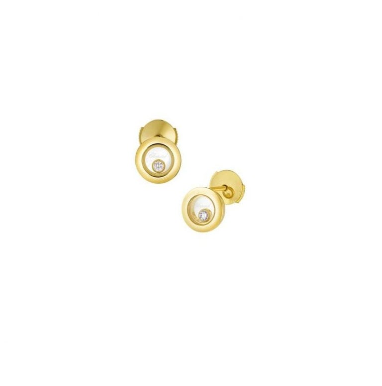Chopard  HAPPY DIAMONDS ICONS EARRINGS PINS  WITH 18-carat yellow gold.  Inspired by sparkling drops of water in a waterfall, the freely moving diamond held between two sapphire crystals on this new round-shaped ear pins in 18K yellow gold swirls