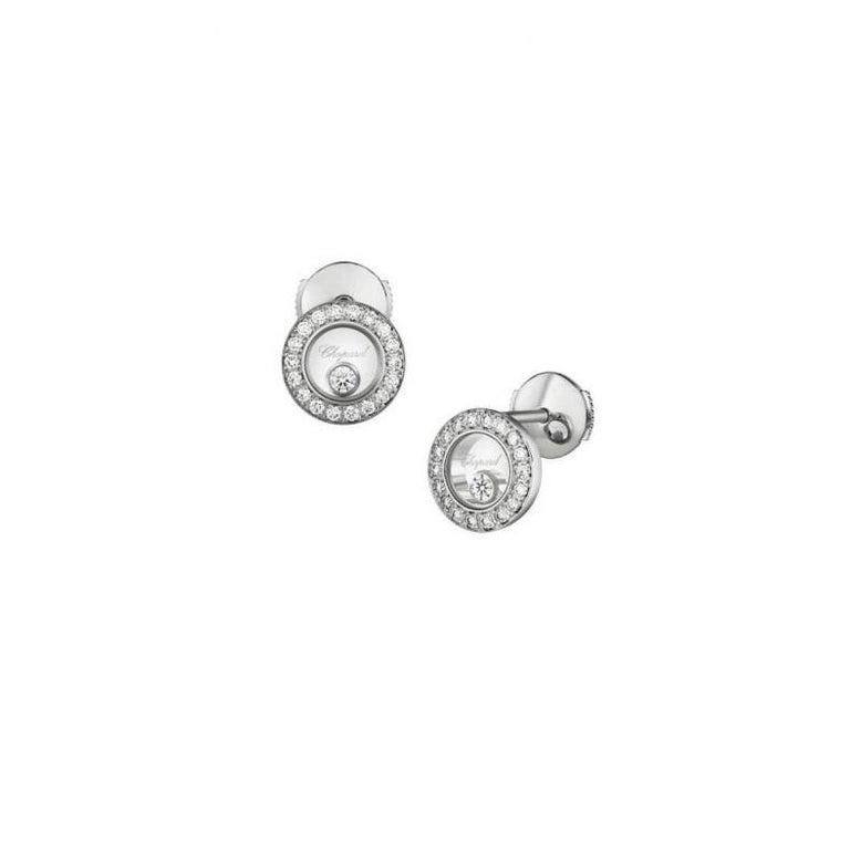 Chopard  HAPPY DIAMONDS ICONS EARRINGS PINS WITH 18-carat white gold and diamonds.  Inspired by sparkling drops of water in a waterfall, the freely-moving diamond held between two sapphire crystals on this new diamond-set round-shaped ear pins in