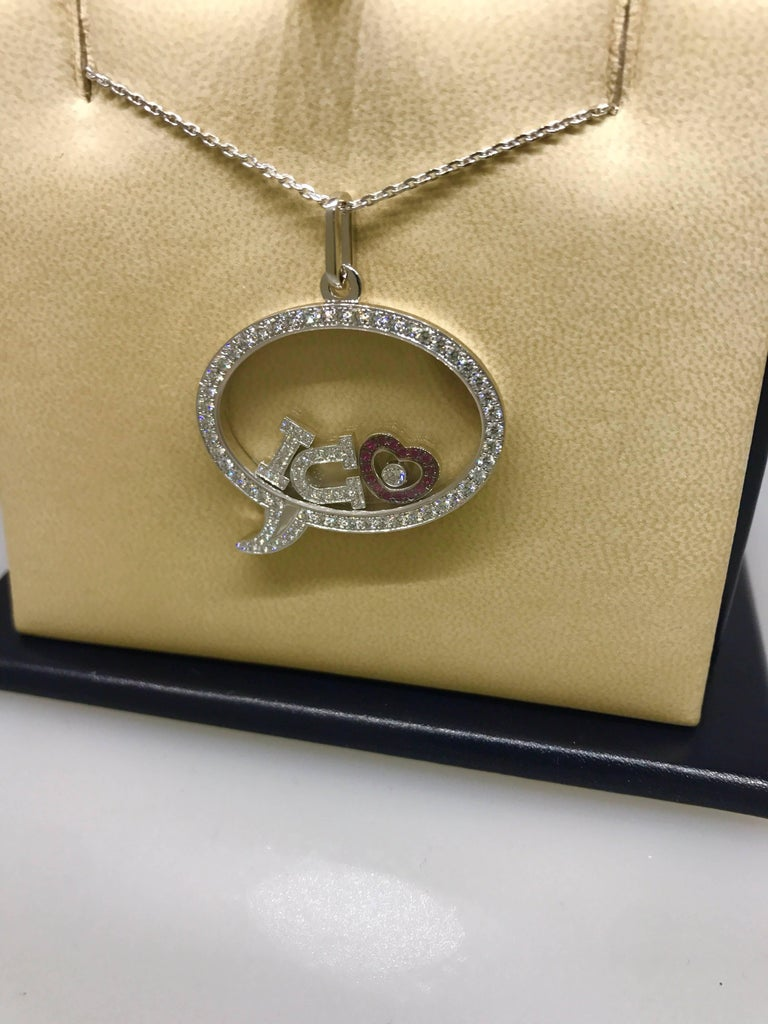 Chopard Happy Diamonds I Love U Pendant / Necklace  Model Number: 79/5749-1003  100% Authentic  Brand New  Comes with original Chopard box, certificate of authenticity and warranty, and jewels manual  18 Karat White Gold (21.60gr)  85 Diamonds on