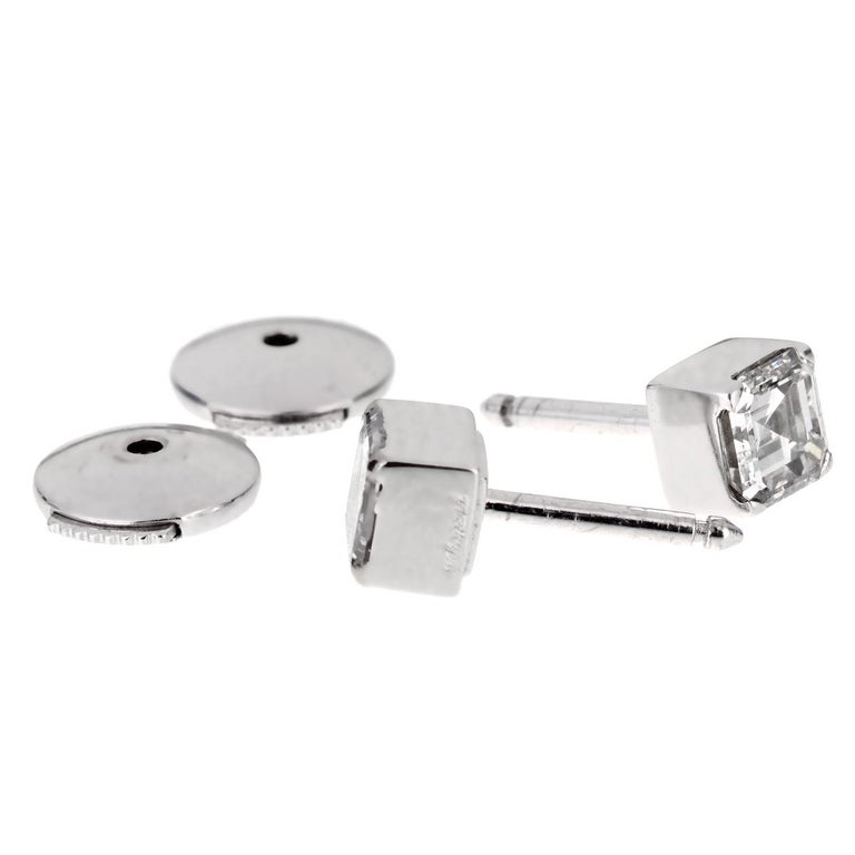 A simple and elegant pair of Chopard diamond stud earrings from the Ice Cube collection. Two square shaped (.96ct total) faceted brilliant diamonds are prong set in high polished 18k white gold.  Sku: 1269