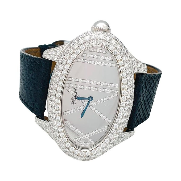 A 18kt white gold Chopard high jewelry watch, set on a leather bracelet. Diamonds paved bezel. Mirror dial,
