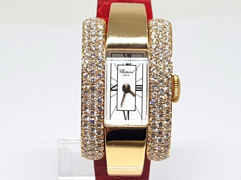 Signed Chopard La Strada ref: 41/7404/8 481548 433 1  Gold: 18K Yellow Gold  White Dial  Quartz Movement  Weight: 42.46 Grams.  Diamonds: 2.05ct.  Width: 2.0 cm.  Length: 17.0cm.  All our jewellery comes with a certificate and a 5 year guarantee