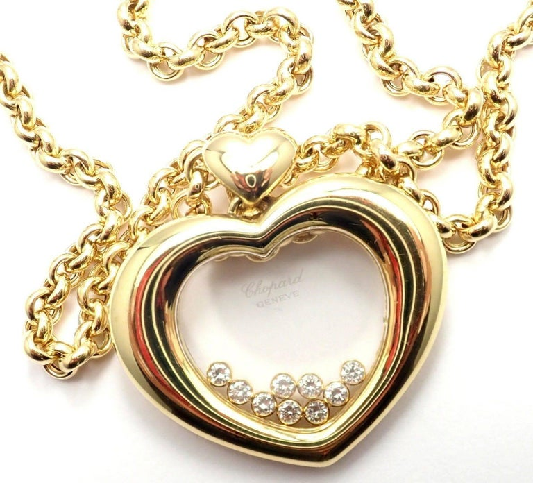 18k Yellow Gold Happy Diamond Large Heart Pendant Necklace by Chopard.  With 39 round brilliant cut diamonds = VVS1 clarity, E color total weight .58ct Details:  Length: 20