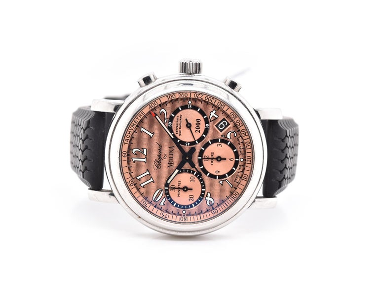 Movement: automatic Function: hours, minutes, seconds, date, chrono Case: 38mm case, push/pull crown, sapphire crystal Band: Chopard black rubber strap with buckle  Dial: copper arabic dial with chrono Reference #: 8331 Serial: 718XXX   50/100  No