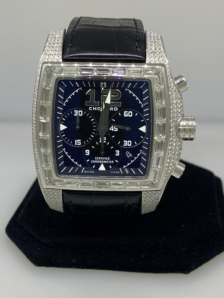 Model Number: 17/2272-1001  100% Authentic  New (Old Stock)  Comes with original Chopard box, certificate of authenticity and warranty, and instruction manual  18 Karat White Gold  Case set with:  28 Trapeze Diamonds (7.45 carats)  623 diamonds
