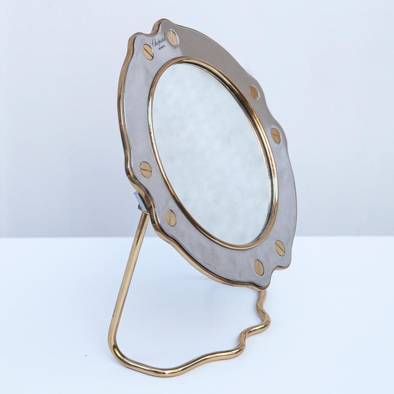 Very rare vintage vanity table mirror made in chrome and brass in the typical Chopard St.Moritz design.  Measures: 30 H x 26 B x 10 D cm.