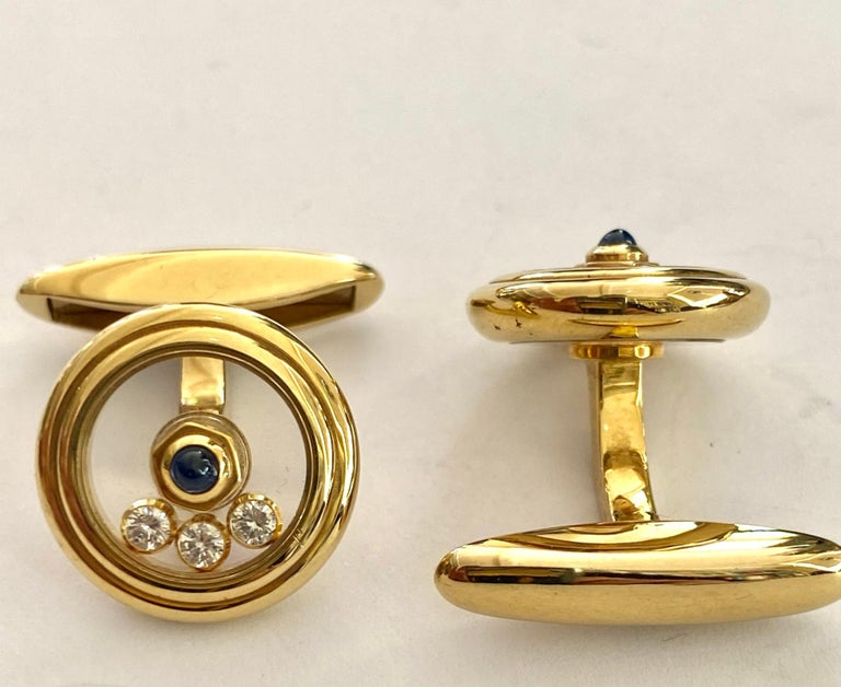 One pair of 18 Karat Yellow Gold Cufflinks, set with each 3 diamonds and one Sapphire. Made By:  CHOPARD Model: