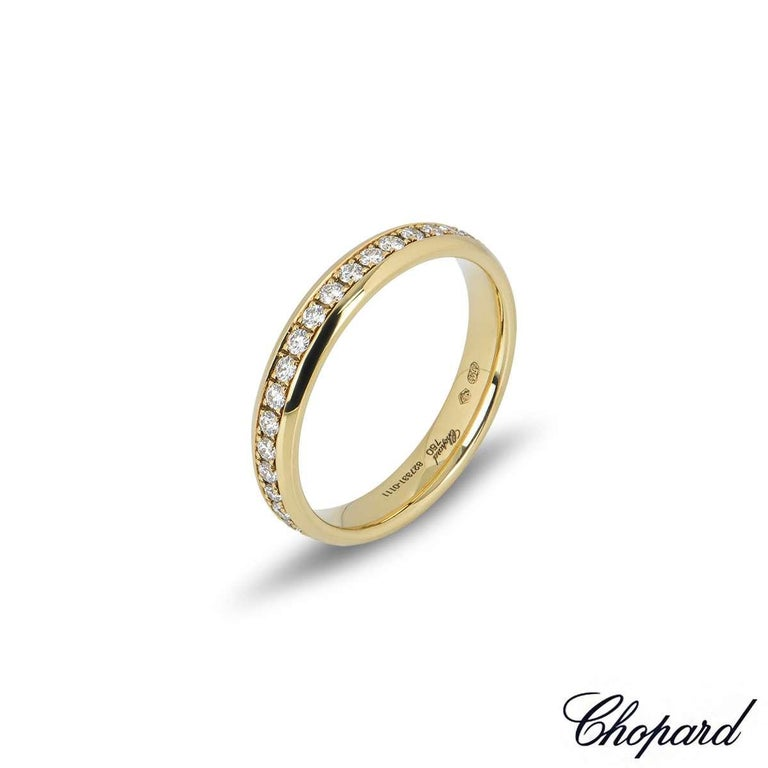 An 18k yellow gold diamond eternity band by Chopard. The ring features 36 round brilliant cut claw set diamonds totalling 0.54ct, F-G colour and IF-VVS in clarity. The 3.5mm wide ring is a size UK N½ - EU 54 - US 6.75 and has a gross weight of 3.7