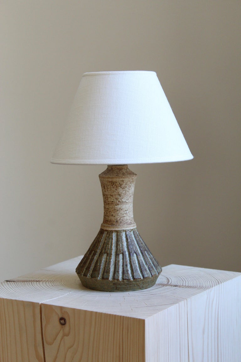 A sculptural table lamp. In glazed stoneware. Designed and produced by Chris Haslev, Denmark, 1960s. Signed.