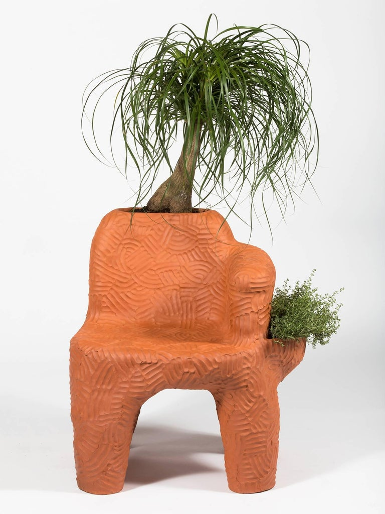 Terracotta chair handmade by New York and Medellín-based artist Chris Wolston. Can be used indoors or outdoors, with or without the plant. Made to order with a lead time of 10-12 weeks.