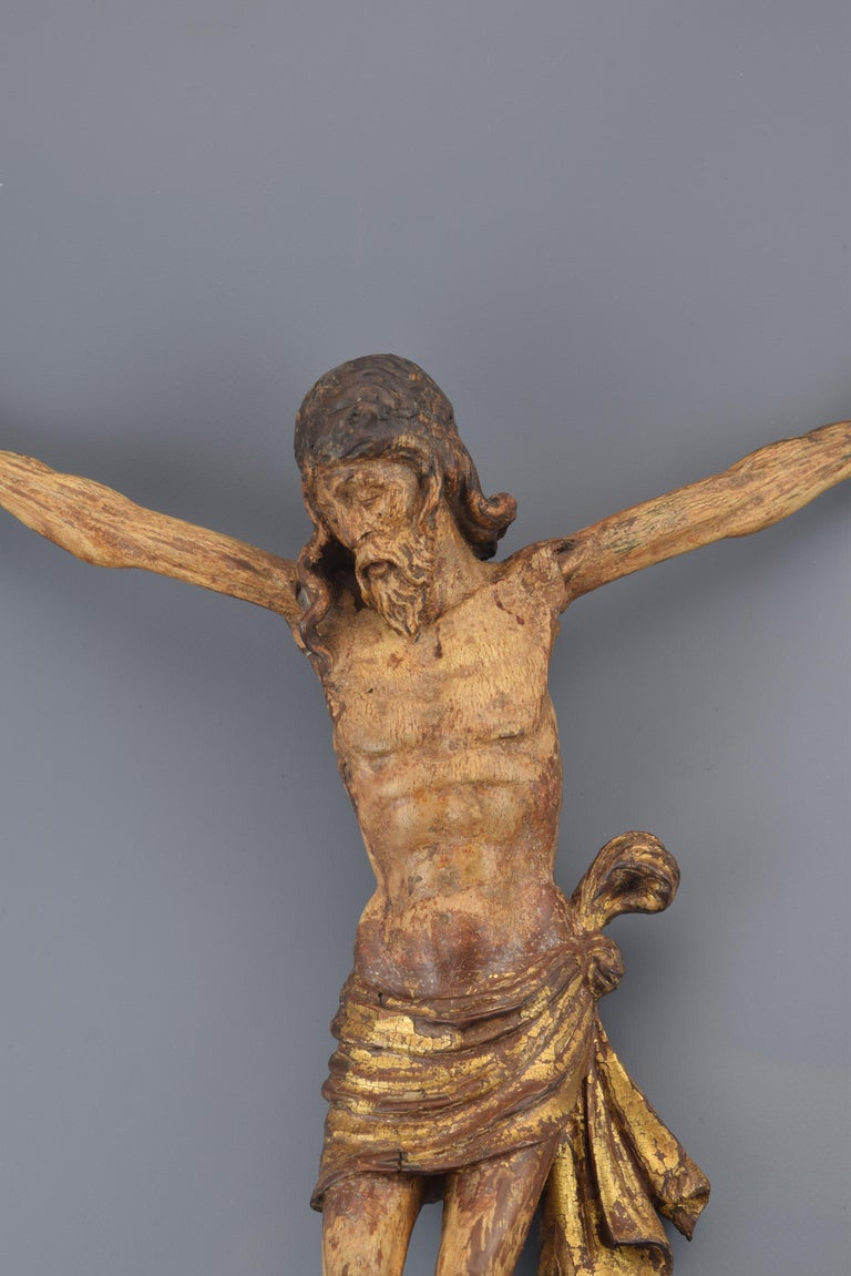 Sculpture in carved wood, gilded and polychrome representing Christ Crucified, with three nails (following a usual iconography since the Gothic) and short purity cloth knotted to one hip, face and head slightly tilted and turned and eyes closed and