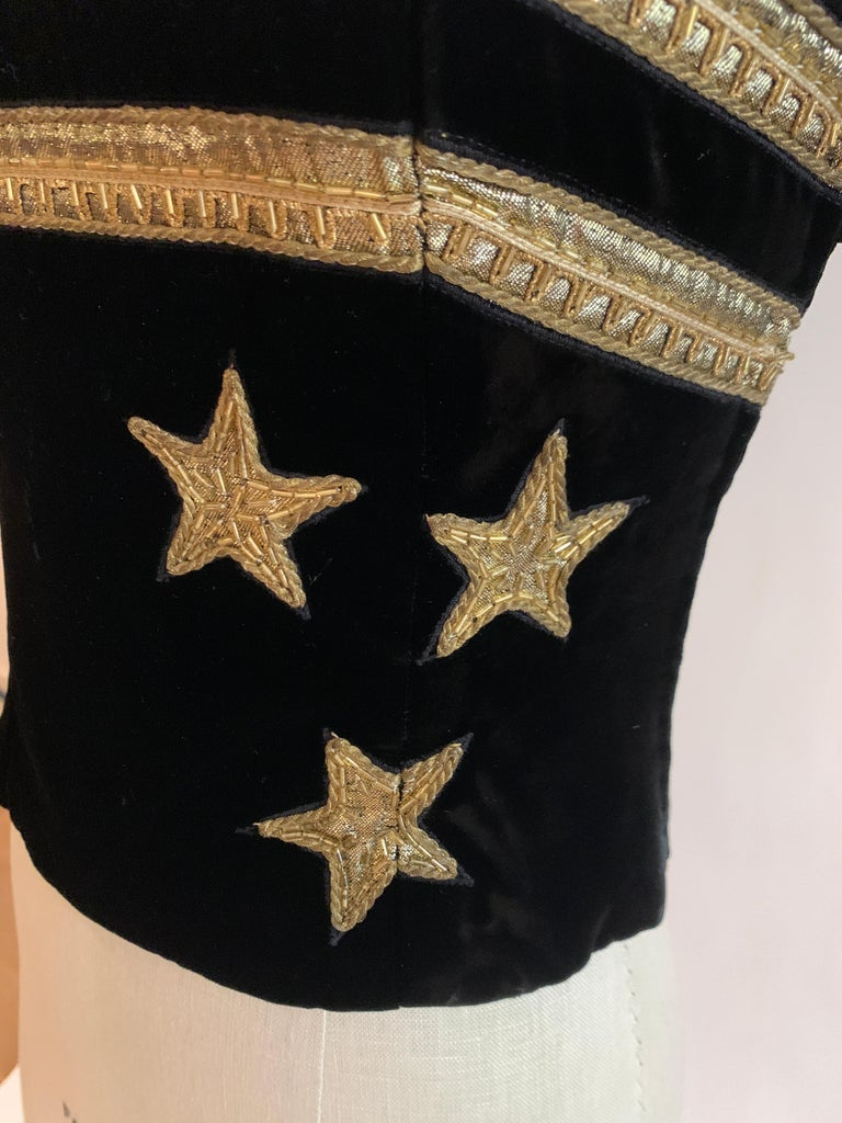 Christian Dior Boutique late 80s/early 90s black velvet corset with gold beaded appliqué star detail and trim at bust. Strapless top closes with side zip and hook and eye. (Photo note: zipper is not zipped all the way up on our mannequin- it is a