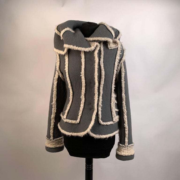 - Christian Dior Shearling Style Jacket - Designed by John Galliano for the 2005 Fall/Winter collection - Gray color - Composition: 53% Wool,30% Mohair, 13% Silk, 4% Angora - Button closure on the front - Long sleeve styling - Size: 38 FR, 10 GB, 36