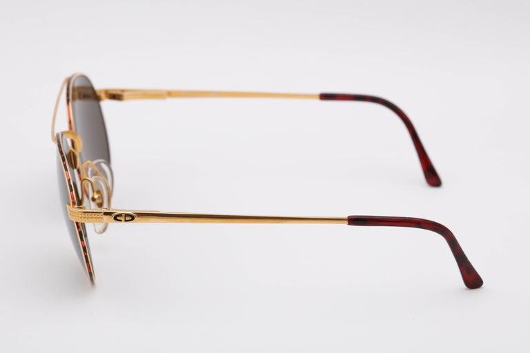 Classic aviator style sunglasses   Frame Width: 140mm Lens Width: 54mm Frame Height: 49mm Arm Length: 105mm