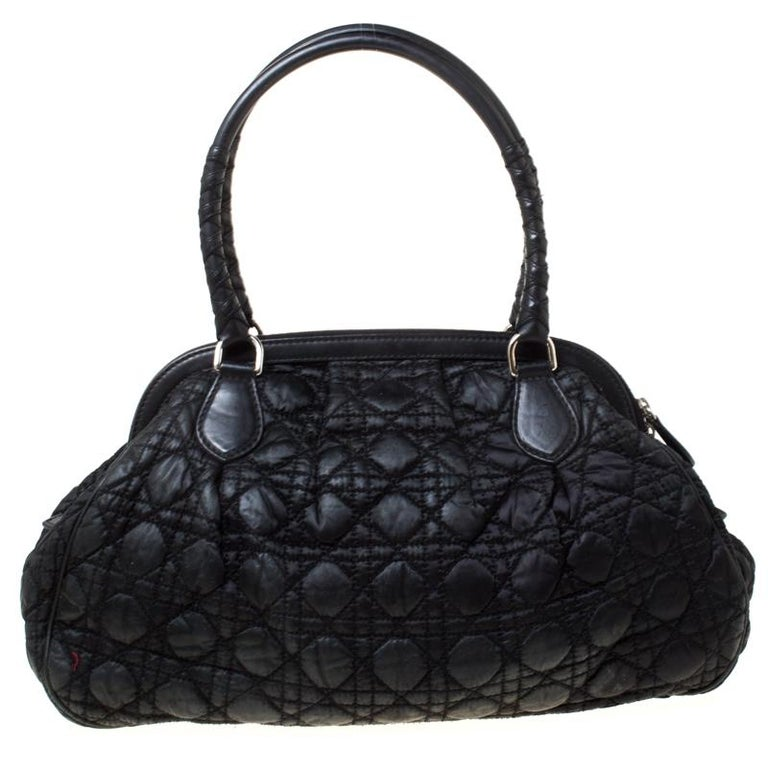 Dior's take on the classic doctor bag, this vintage-inspired Dior quilted satin bag has a capacious compartment to hold your daily accompaniments. It features the signature cannage quilted pattern and is nicely finished with braided details on the