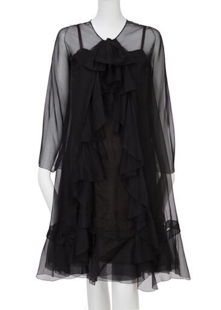 Haute Couture Spring/Summer 1966, black silk chiffon dress with spaghetti straps and long sleeved jacket with ruffle detail to the front.