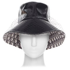 CHRISTIAN DIOR black faux leather net mesh trimmed monogram oblique bucket hat