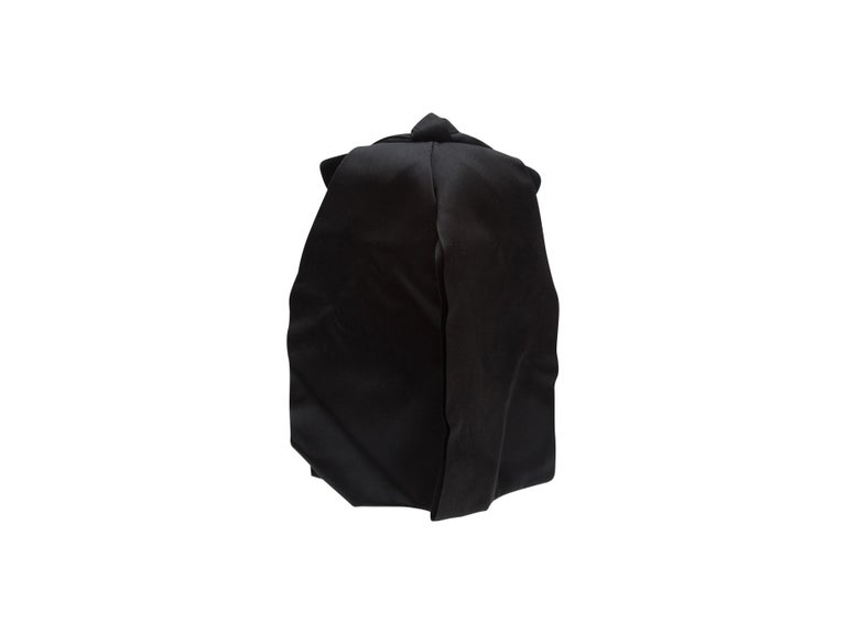 Product details:  Vintage black velvet hat by Christian Dior.  Circa the 1950s - 60s. Black satin bow.  17