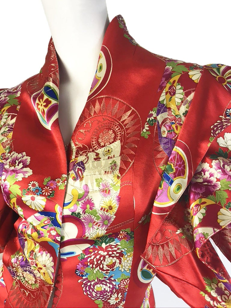 Christian Dior Boutique by Galliano red silk printed jacket with exaggerated sleeves. Condition: Excellent except for mark on label.  Sz F 36/ US 4 ( mannequin is a size 6 )