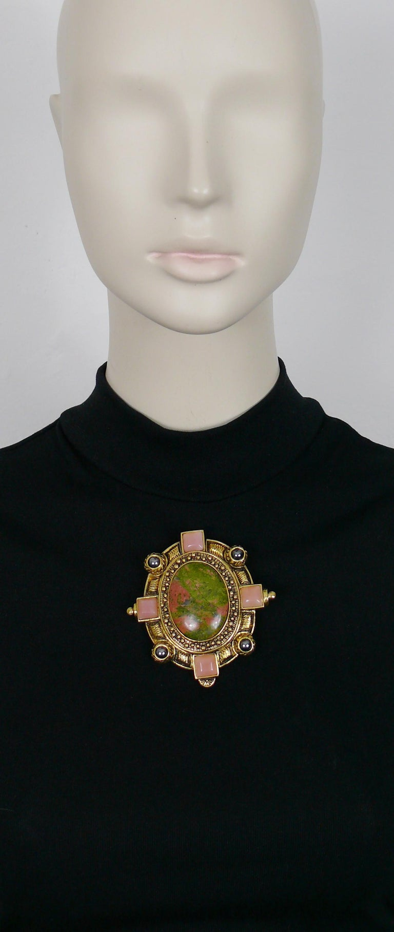 CHRISTIAN DIOR BOUTIQUE vintage massive antiqued gold toned brooch embellished with a large oval hard stone cabochon (marbled green and pink colours), hematite colour beads and square baby pink glass cabochons.  Could be worn as a brooch or