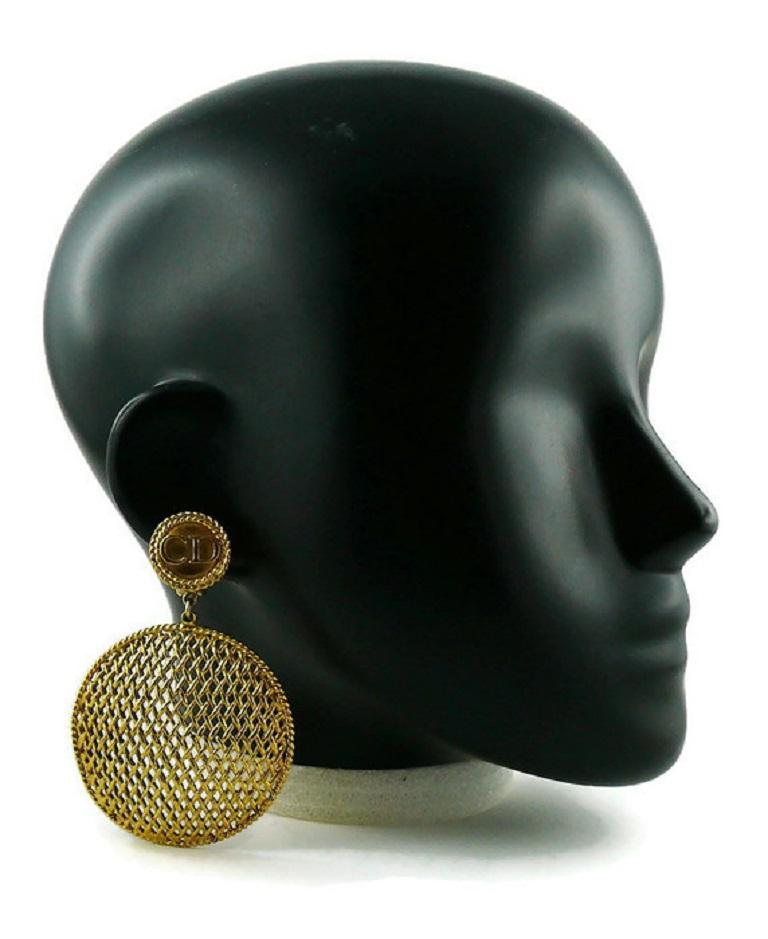 CHRISTIAN DIOR BOUTIQUE vintage gold toned dangling earrings (clip-on) featuring a massive disc with openwork woven design and CD monogram top.  GIANFRANCO FERRE era.  Marked CHRISTIAN DIOR BOUTIQUE.  Indicative measurements : height approx. 8.5 cm